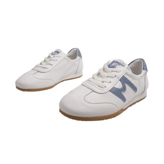 Кросівки жіночі з натуральної шкіри, на низькому ходу, білі, Vikonty
